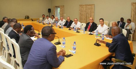 PHOTO: Haiti President Jovenel Moise meets with Cubans to discuss construction of more hydroelectric dams