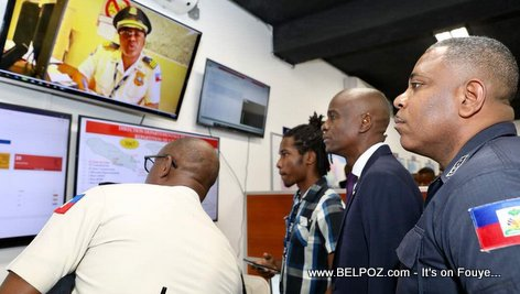 Haiti's Police chief Michel Ange Gedeon showing President Jovenel Moise around Police Headquarters
